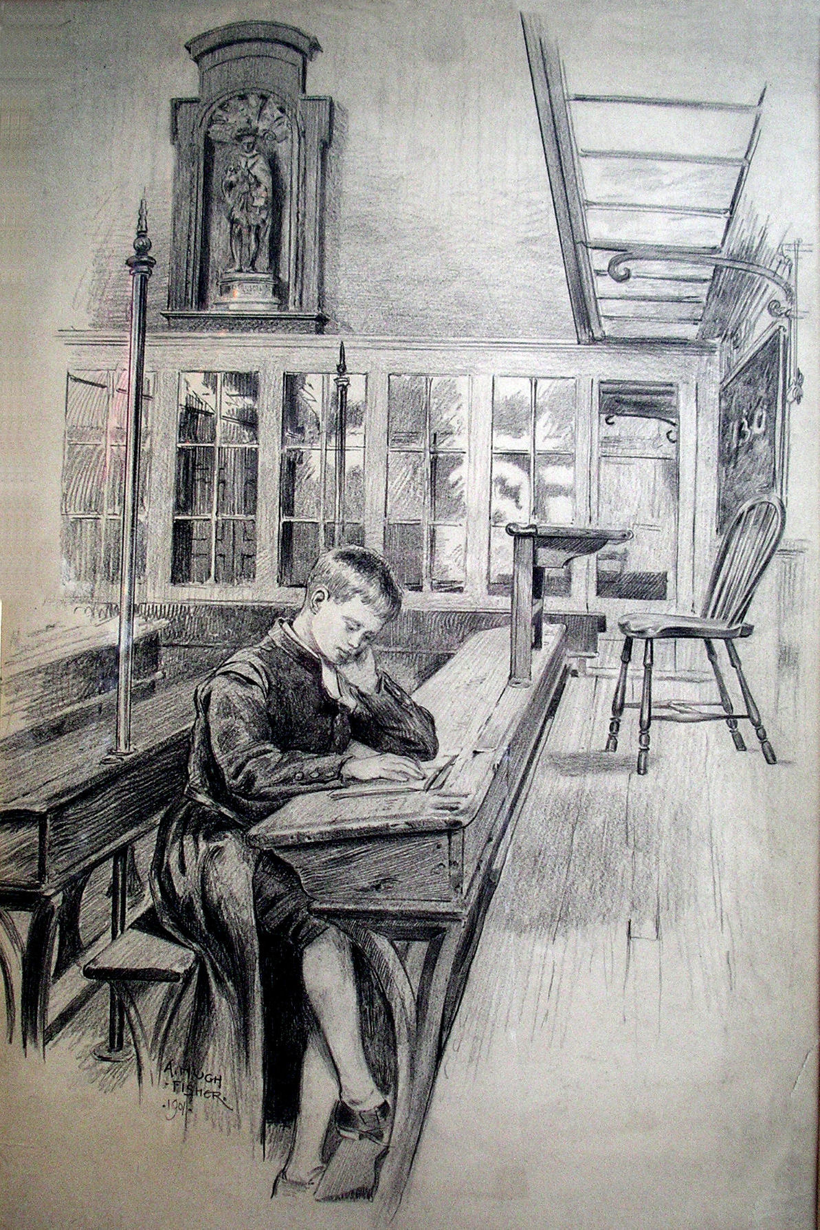 Boy reading in a classroom